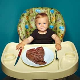 baby eating steak