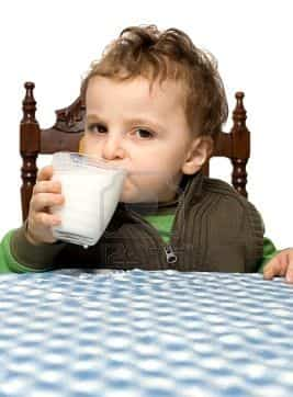 3933393 baby boy drinking milk at the table