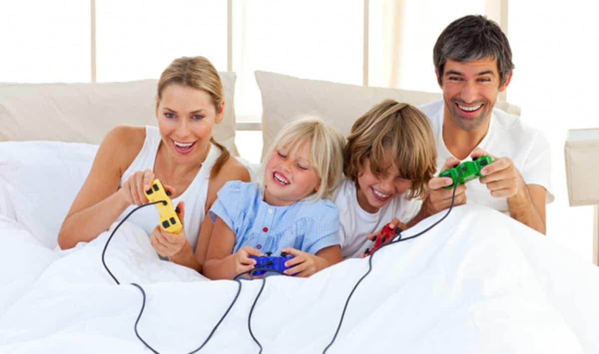 depositphotos 10293358 stock photo adorable family playing video game