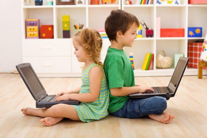 depositphotos 6430248 stock photo kids with laptops computer generation